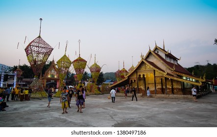 """NA HAEO, LOEI, THAILAND - 14 April, 2019: Visitors visit the """"Hae Ton Dork Mai"""" or the traditional flower parade of Saengpha Subdistrict, Na Haeo District, Loei Province. Held in April every year."""
