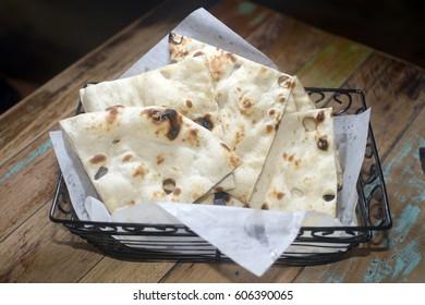 naan bread in basket fresh baked