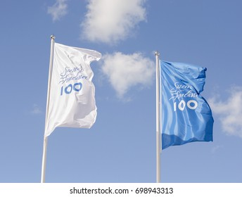 Naantali, Finland - August 3 2017. The flags for the celebration of Finlands first 100 hundred years wave in the wind on a sunny summers day in the city of Naantali near Turku, Finland.