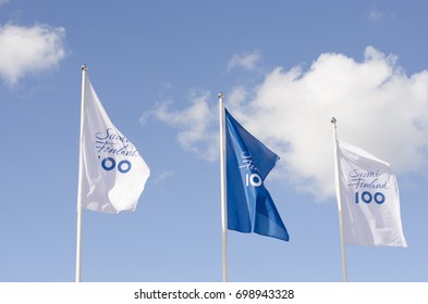 Naantali, Finland - August 3 2017. The flags for the celebration of Finland first 100 hundred years wave in the wind on a sunny summers day in the city of Naantali near Turku, Finland.