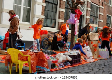 NAARDEN - APRIL 30:  Dutch annual national holiday, in the streets of the city, with unidentified children on April 30, 2013 in Naarden, The Netherlands