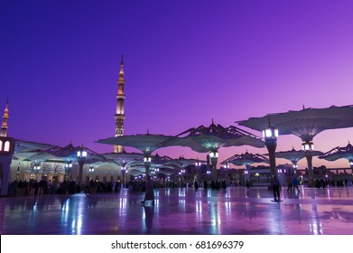 Nabawi mosque during sunrise golden hour.