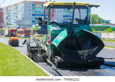 Naberezhnye Chelny, Russia, August 20 2017. Work on laying the asphalt surface on a busy city street. Machines for laying asphalt