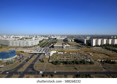 Naberezhnye Chelny, Russia - August 31, 2016: Summer cityscape broad avenues, high-rise buildings, industrial area and the forest on the horizon, the view from the top.