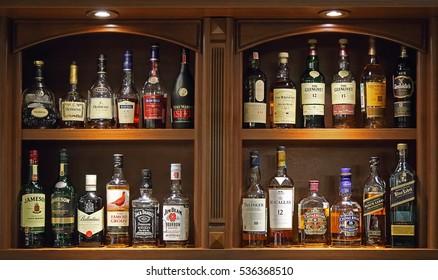Naberezhnye Chelny, Tatarstan / Russia ?? September 21, 2016: Bottles of various alcoholic drinks at wooden Bar cabinet