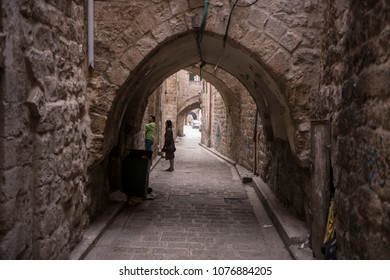Nablus, Palestine - December 19 2017: The narrow historic street with the Arabic-style arch in old town Nablus.