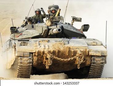 NACHAL OZ, ISR - NOV 12:Israeli soldiers drive Merkava on NOV 12 2008.It's IDF battle tank designed for rapid repair of battle damage, survivability, cost-effectiveness and off-road performance.