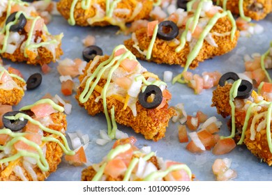 Nacho chicken wings with avocado cream and salsa