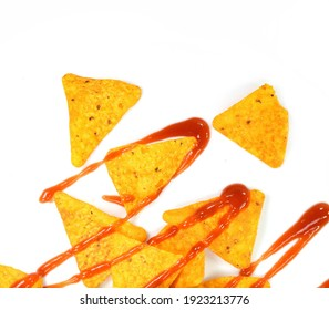 Nachos in the Bowl and Tomato Sauce in the Dipper - Isolated. Tasty nachos and bowl with ketchup isolated on white