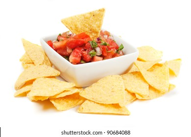 Nachos corn chips with fresh homemade salsa isolated on white