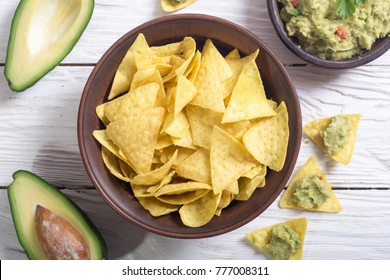 Nachos with guacamole from avocado . Mexican food background