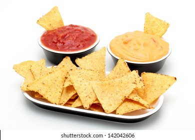 nachos with sauce on white background