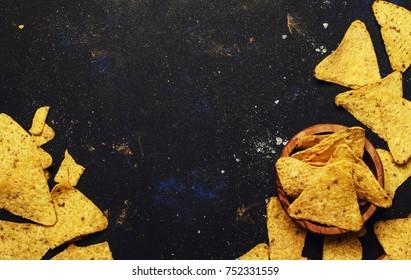 Nachos In Wooden Bowl, Black Background, Top View