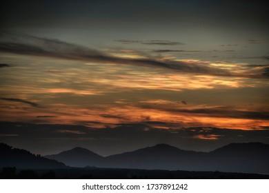 Nacreous cloud over mountain area in evening