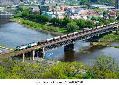 Ústí nad Labem, Czechia - May 5 2019: a train crossing the railway bridge over the Elbe (Labe) river