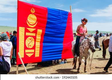 NADAAM HORSE RACE OUTSIDE ULAANBAATAR, MONGOLIA - JULY 12, 2010: Mongolian flag at Nadaam horse race, the most important festival of the year in Mongolia from 11-13 July.