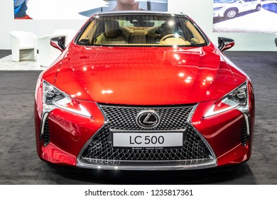 Nadarzyn, Poland, November 16, 2018: metallic red LEXUS LC 500 LUXURY COUPE EXHILARATING DRIVE at Warsaw Motor Show, produced by Japanese car maker Lexus