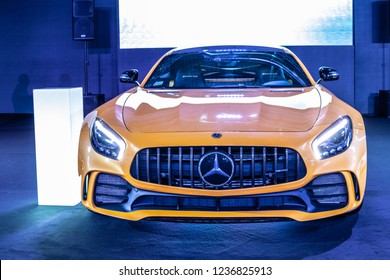 Nadarzyn, Poland, November 16, 2018: metallic yellow gold Mercedes-AMG GT R V8 bi-turbo, a luxury sport car at Warsaw Motor Show, produced by Mercedes AMG