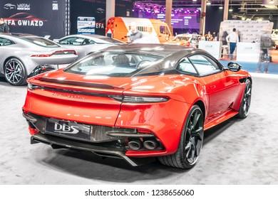 Nadarzyn, Poland, November 16, 2018: red Aston Martin DBS at Warsaw Motor Show, British super grand tourer manufactured by UK automotive manufacturer Aston Martin