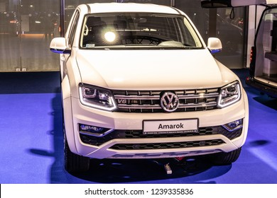 Nadarzyn, Poland, November 16, 2018: metallic white Volkswagen VW Amarok V6 4Motion truck pickup at Warsaw Motor Show, produced by German automaker Volkswagen Group