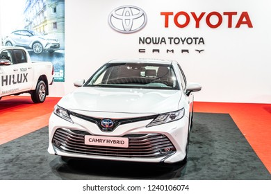 Nadarzyn, Poland, November 16, 2018: metallic white all new Toyota Camry Hybrid at Warsaw Motor Show, produced by Japanese automaker, Toyota booth