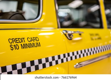 """Nadarzyn, Poland, October 27, 2017 Warsaw Moto Show: Iconic vintage metallic yellow Checker Marathon Taxi Cab 1965, from movie """"Taxi Driver"""". glossy and shiny old classic retro auto, New York Taxi"""