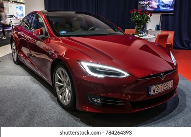 Nadarzyn, Poland, October 27, 2017: metallic red Tesla Model S 60D at Warsaw Moto Show, produced by American automaker Tesla, owned by Elon Musk - main shareholder