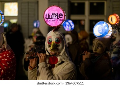 Nadelberg, Basel, Switzerland - March 11th, 2019. Close-up of piccolo players in their individual carnival costumes with illuminated head lanterns.