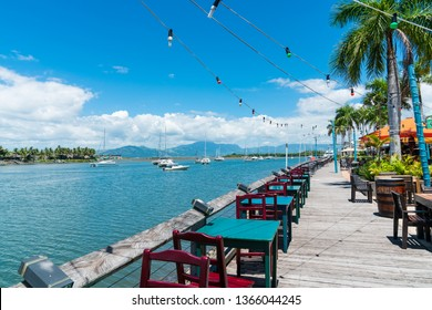 NADI, FIJI 23rd DECEMBER 2018 - Restaurant tables by the bay right at the edge of the water with yachts parked in the bay