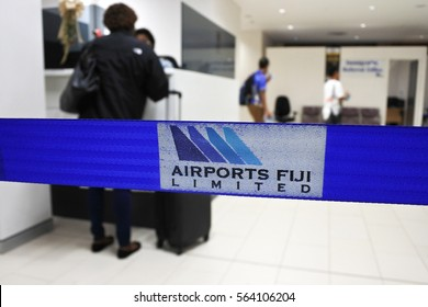 NADI, FIJI - DEC 11 2016:Passengers arrive at Nadi International Airport, the main international airport for the Republic of Fiji as well as an important regional hub for the South Pacific islands.