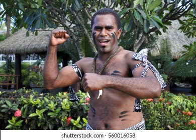 NADI, FIJI - JAN 01 2017:Indigenous Fijian man greeting Bula,(Hello in Fijian). Indigenous Fijians are the indigenous people of Fiji Islands arrived from western Melanesia about 3,500 years ago