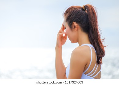 Nadi Shodhana Pran. Woman Yoga. Woman practice meditation at the coast. Relex in nature.