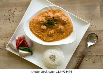 Nadru Ke kofte or kamal kakdikoftacurryis tasty and mildly spiced yoghurt based Kashmiri recipe.