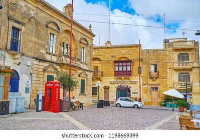 NADUR, MALTA - JUNE 15, 2018: The Market square with historic edifices and classic British red telephone box, on June 15 in Nadur.