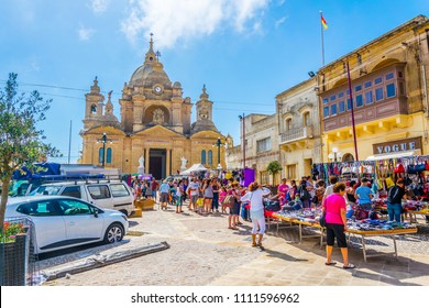 NADUR, MALTA, JUNE 7, 2017: View of a traditional market on the main square of Nadur, Gozo, Malta