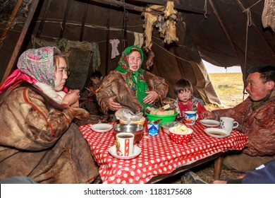 Nadym, Russia - august 27, 2018:tundra, The extreme north, Yamal, the pasture of Nenets people, the dwelling of the peoples of the north, the yurt, artistic toning, big family drinks tea in a yurt