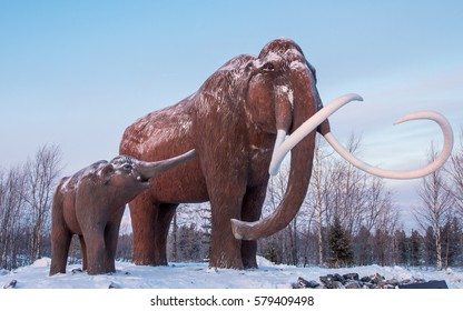 NADYM, RUSSIA - CIRCA JANUARY 2017: Mammoths (mother and baby)  monument near road to Nadym town in Western Siberia, Russia