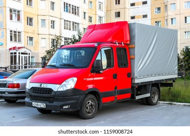 Nadym, Russia - July 14, 2018: Cargo van Iveco Daily 35C15 in the city street.