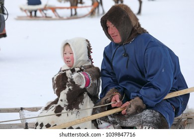 NADYM, RUSSIA - MARCH 04, 2018: Father and daughter Nenets during the traditional holiday of the reindeer breeder Day. Nenets - aboriginals of the Russian North