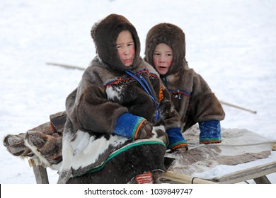 NADYM, RUSSIA - MARCH 04, 2018: Two boys Nenets during the traditional holiday of the reindeer breeder Day. Nenets - aboriginals of the Russian North