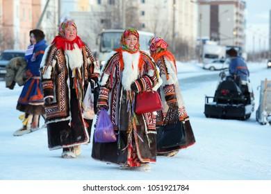 NADYM, RUSSIA - MARCH 04, 2018: Nenets women in bright traditional fur garments malitsa