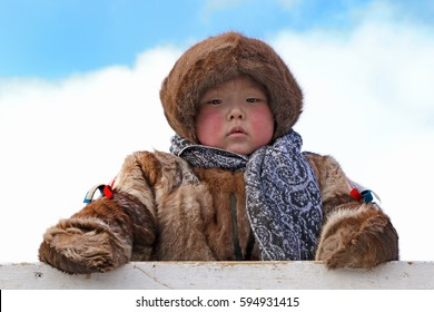 "NADYM, RUSSIA - MARCH 05, 2017: Boy reindeer breeder Nenets in national clothes on a traditional holiday ""Day of the reindeer breeder"". Nenets - aboriginals of the Russian North"