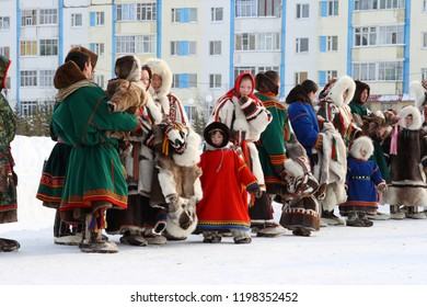 NADYM, RUSSIA-MARCH 07, 2010: Nenets men and women in national fur clothes. Nenets - aboriginals of the Russian North
