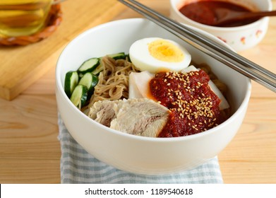 Naengmyeon  is a Korean noodle dish of long and thin handmade noodles made from the flour and starch of various ingredients, including buckwheat, potatoes, sweet potatoes, arrowroot starch and kudzu.