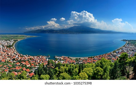 """NAFPAKTOS (LEPANTO) TOWN, AITOLOAKARNANIA, GREECE. Panoramic view (4 vertical photos """"stitched"""") of the town from its castle. In the background the northern coast of Peloponnese."""