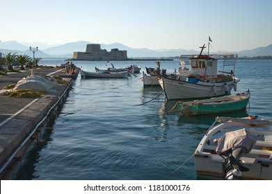 NAFPLIO, GREECE - JULY 10, 2009: moored boat in the bay of Nauplion, on background the castle of Bourtzi