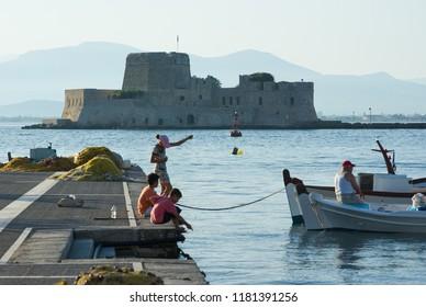 NAFPLIO, GREECE - JULY 10, 2009: venetian Castle of Bourtzi in the Bay of Nauplion