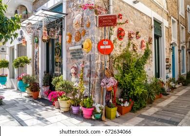 NAFPLIO, GREECE - MAY 10, 2017: outside traditional tavern restaurant, pedestrian street in central Nafplio, Peloponnese, Greece
