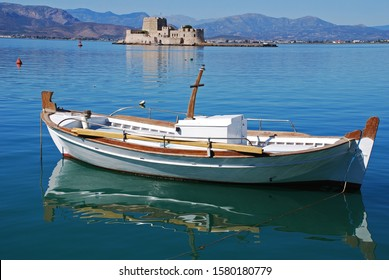 NAFPLIO, GREECE - OCTOBER 2008: Lonely boat and fortified island in Nafplio