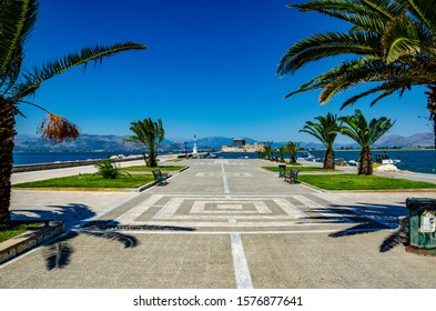 NAFPLIO, GREECE - OCTOBER 2015: Panoramic view from the waterfront of the coastal city of Nafplio. Beautiful Spring colors around the picturesque port of Nafplio city, Greece